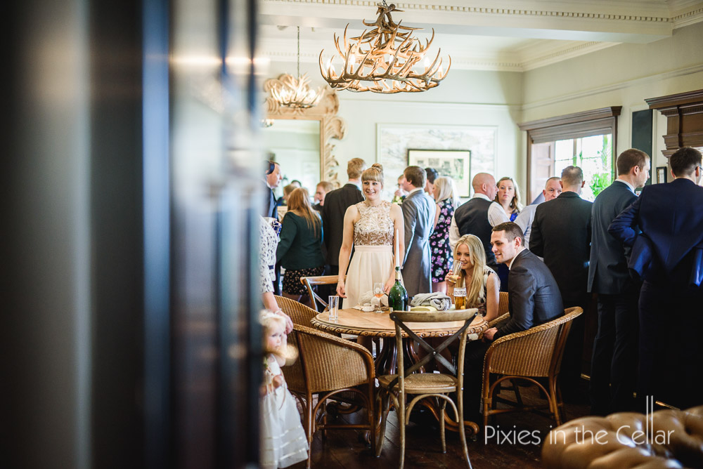 eaves hall bar with wedding guests