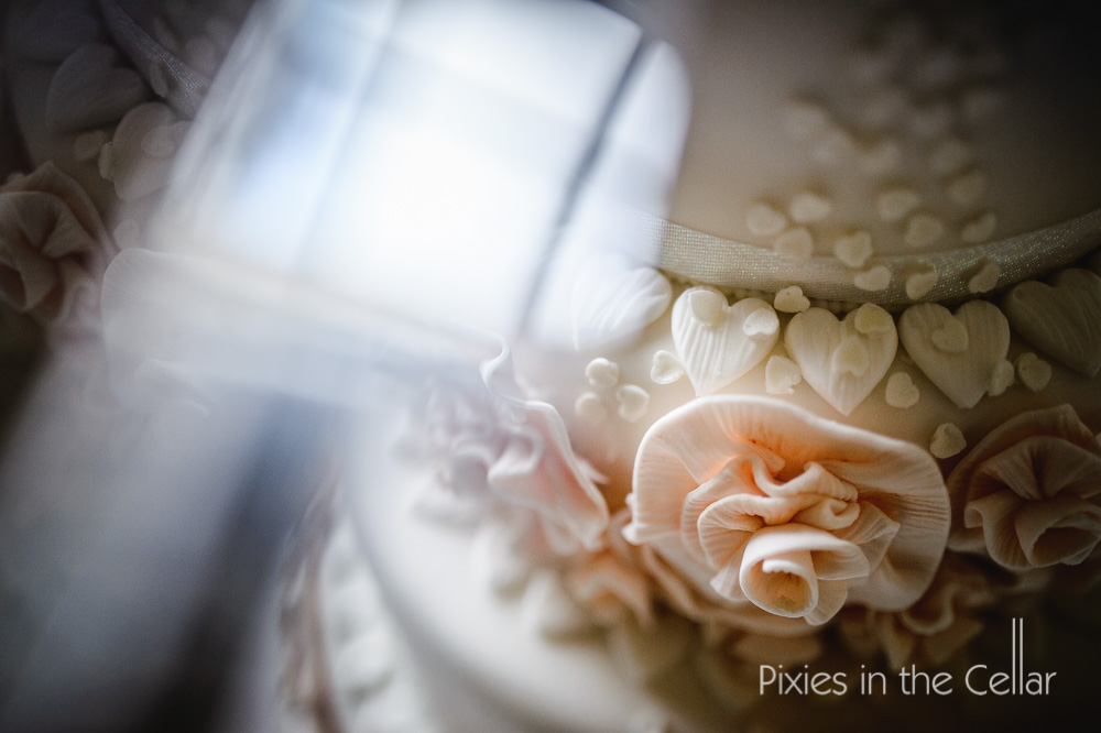 Hearts and flowers wedding cake detail