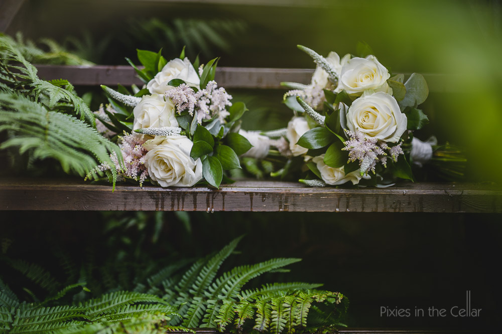 white rose pinks and green leaf bouquet