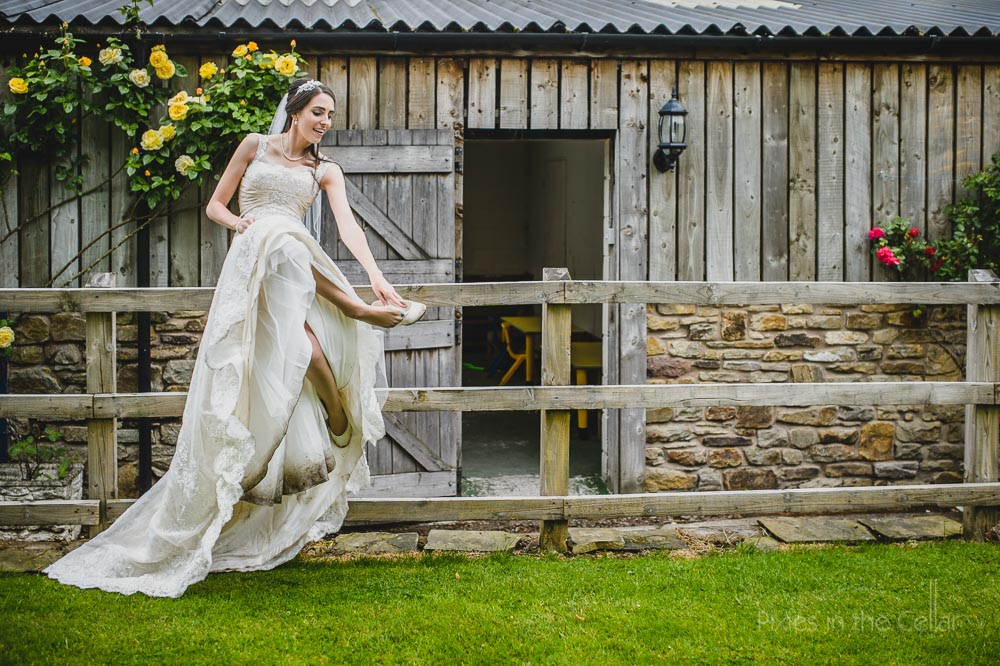 hyde bank farm wedding photographer bride on fence