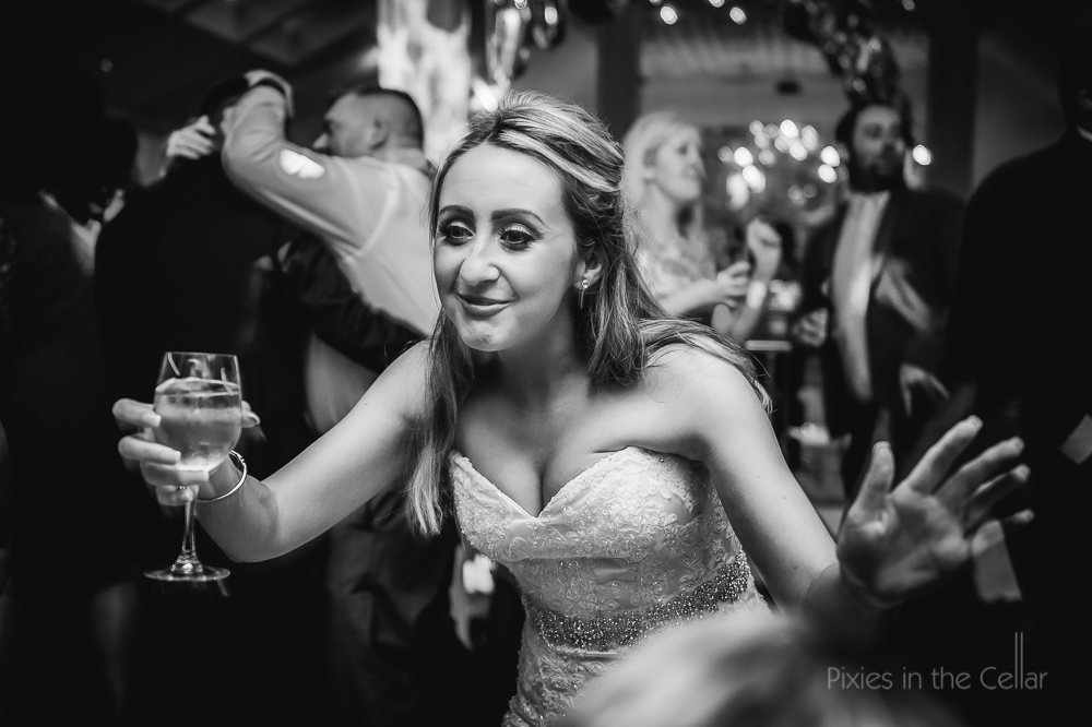 bride dancing with wine