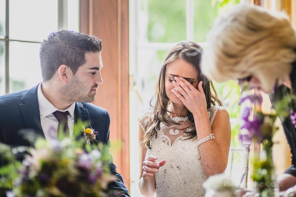 emotional bride signing register