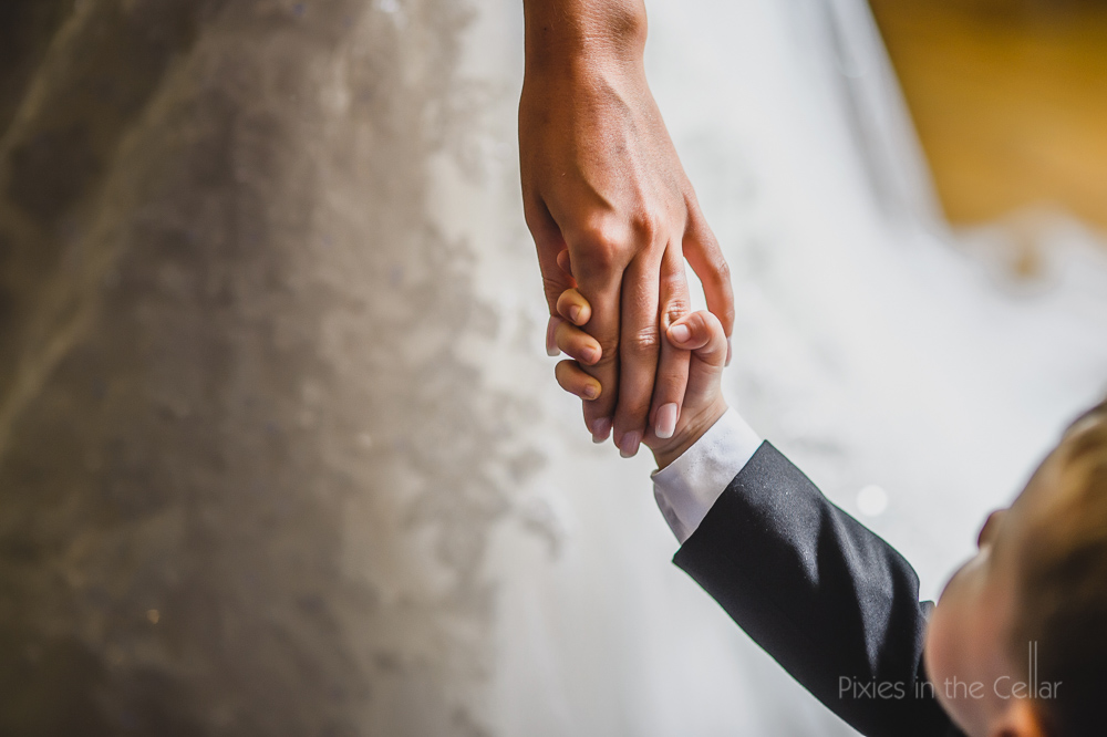 mother and son wedding hands