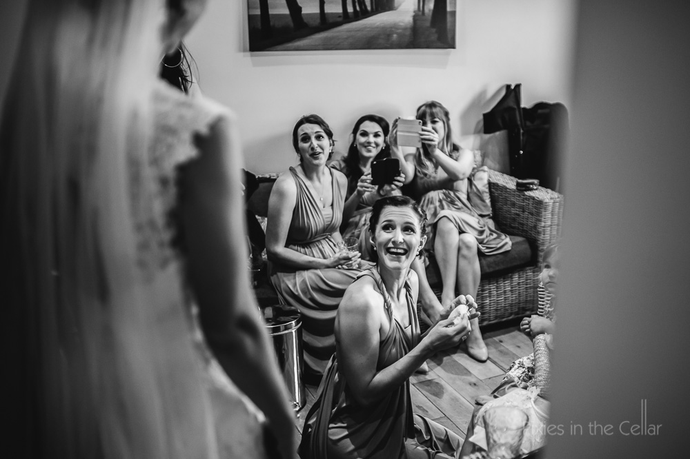 bridesmaids admiring bride