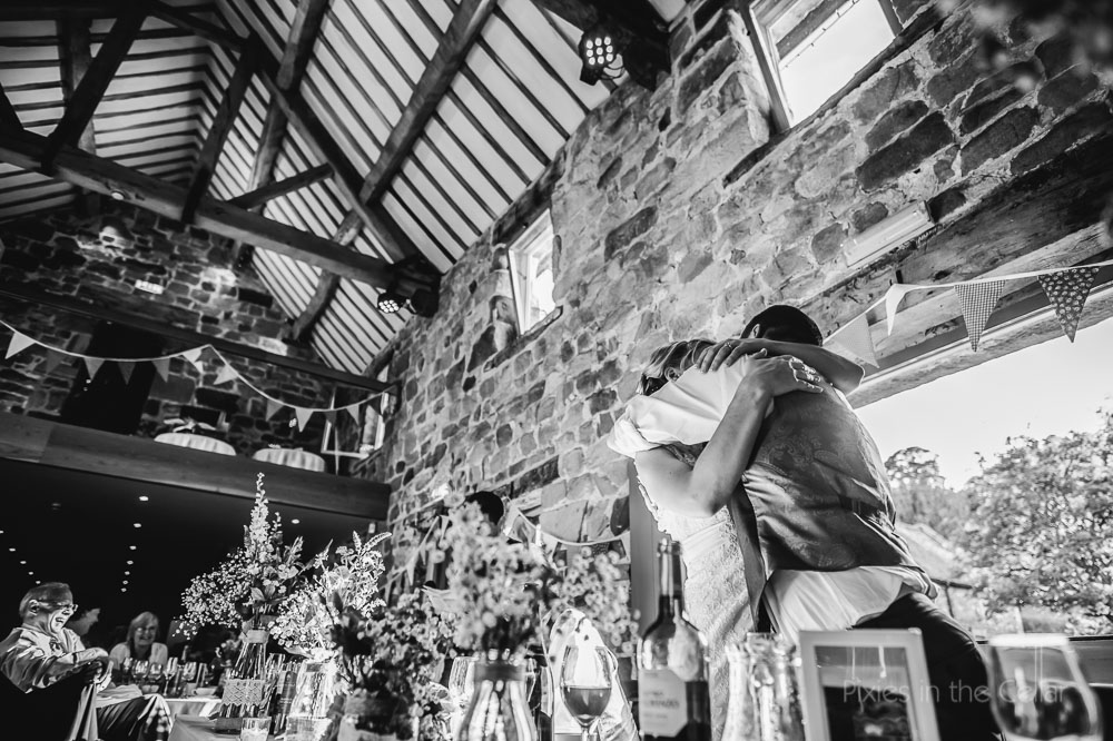 wedding hugs at The Ashes Barn