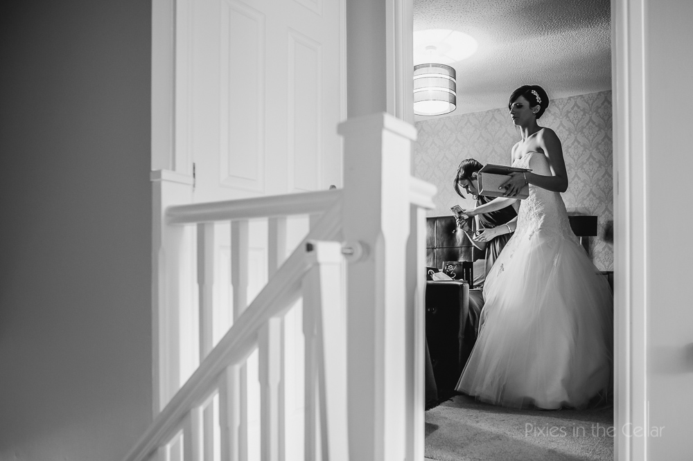 bride getting ready with handbag