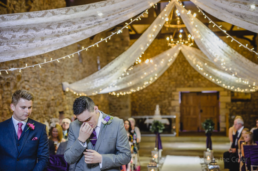 groom waiting tithe barn