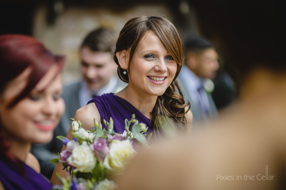 smiling bridesmaid purple