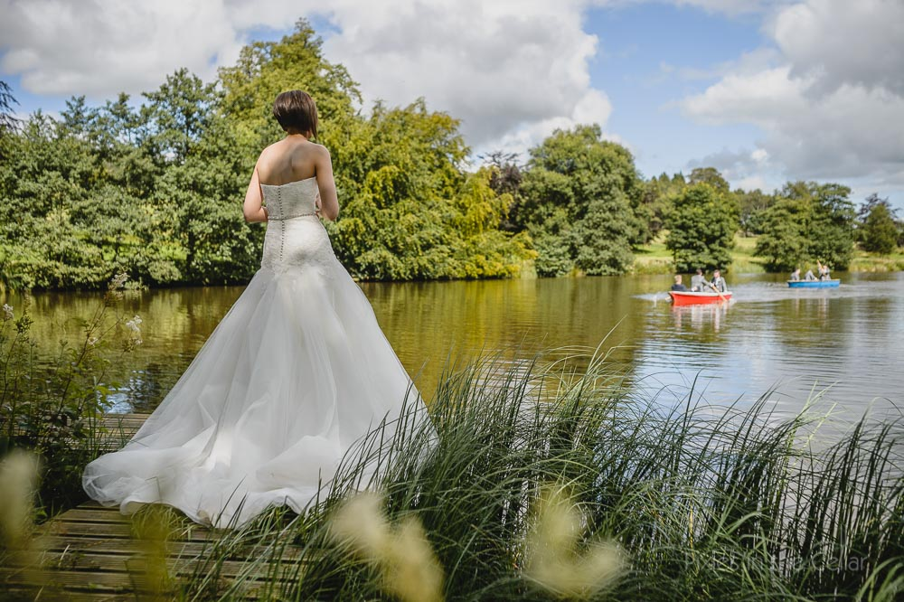 Bride looking over lake at Browsholme Hall