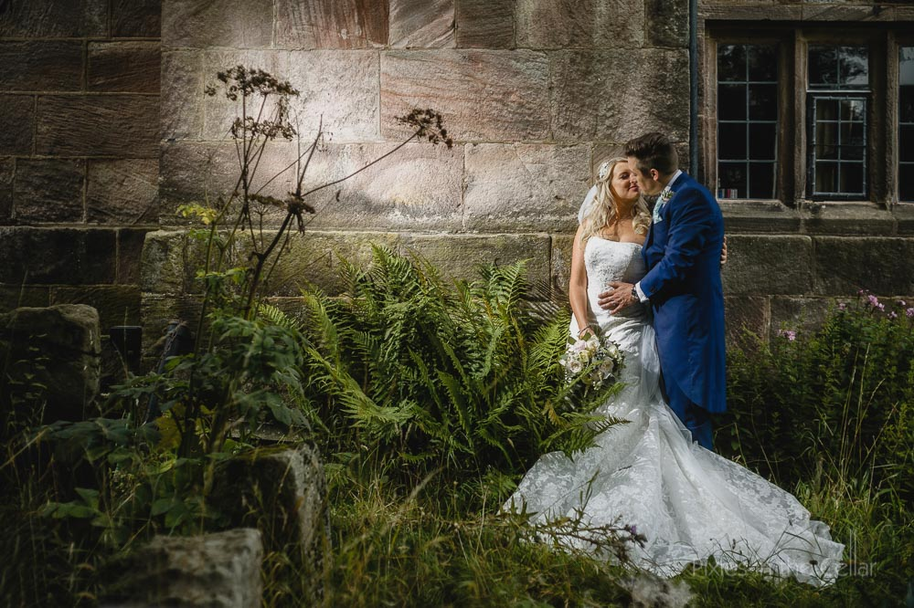 bride groom ferns wall