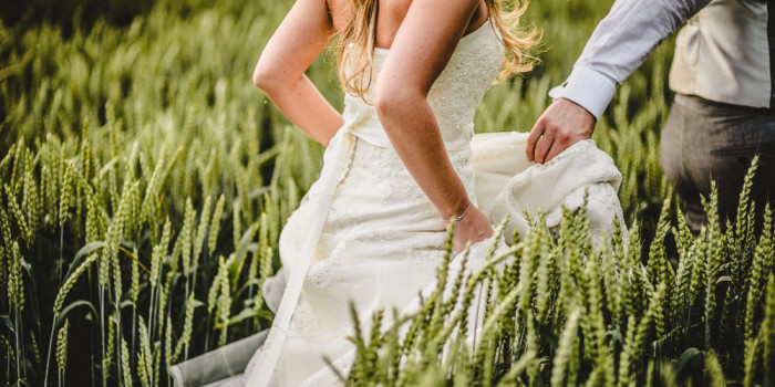 Sanhole Oak barn wedding bride and groom barley field