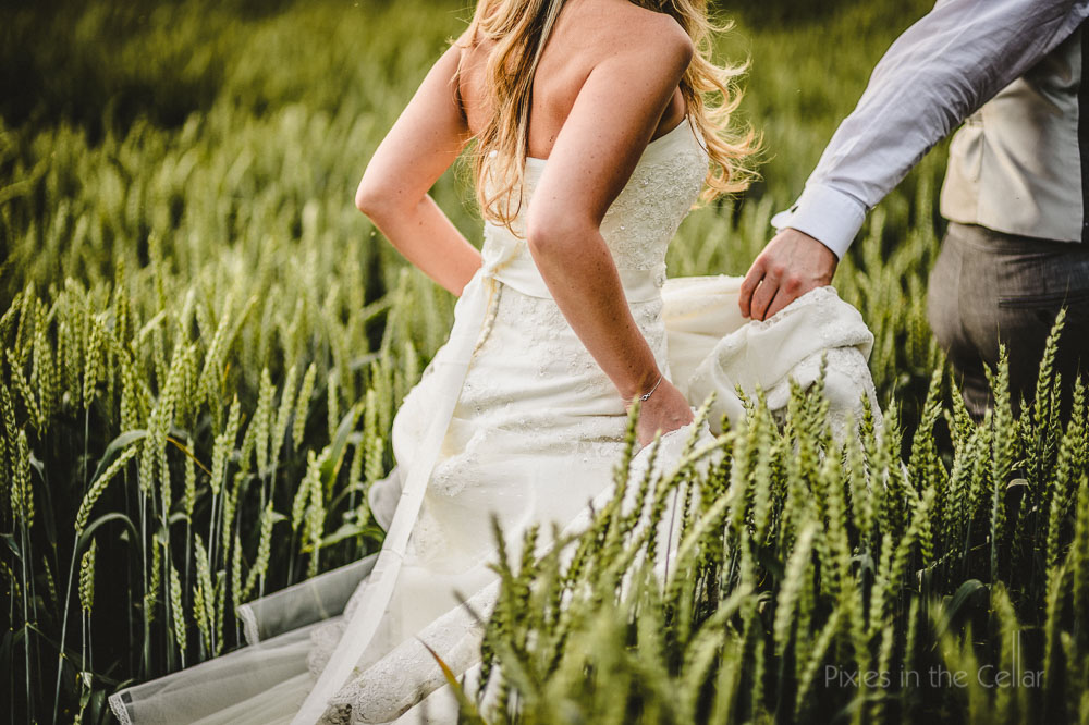 Sanhole Oak barn wedding bride and groom barley field