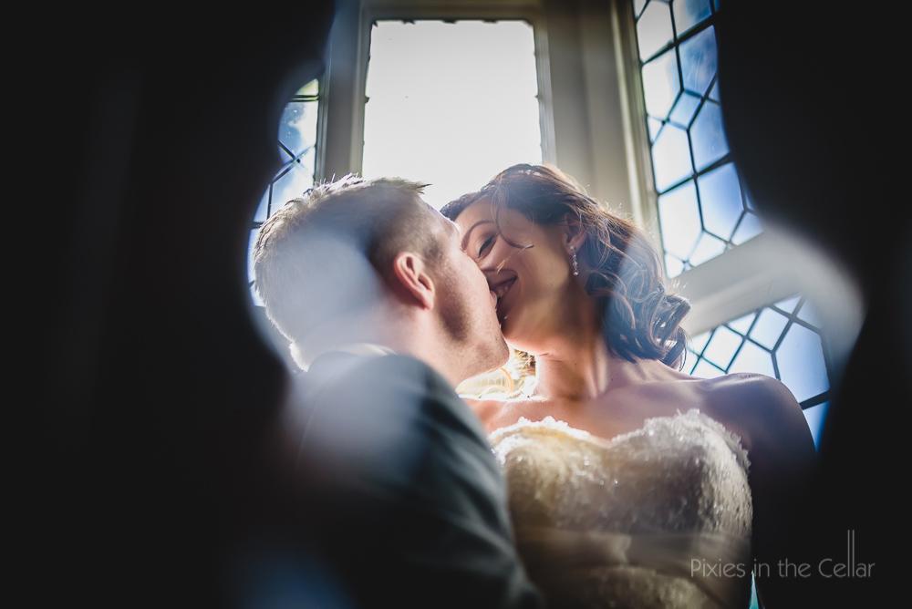 kissing bride groom