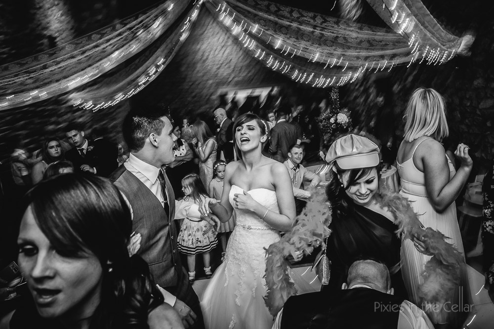 bride and groom dancing party