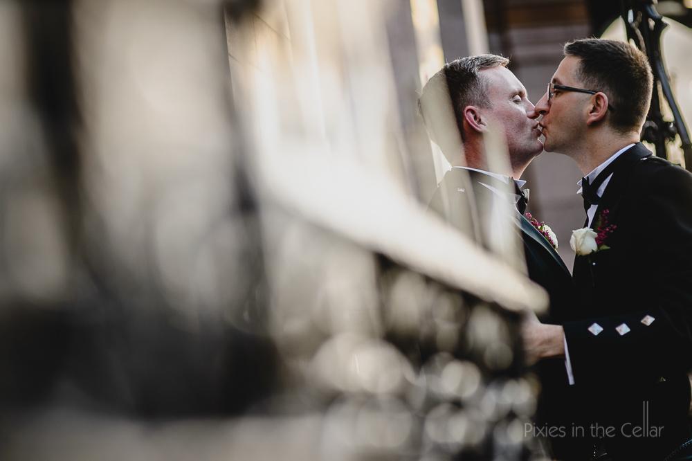 kissing gay wedding couple