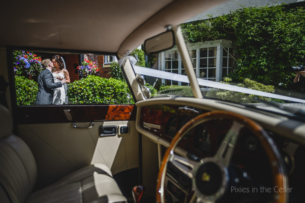 car wedding kiss