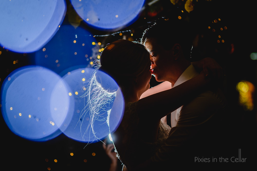 Alrewas hayes wedding photography fairy lights bride groom kissing