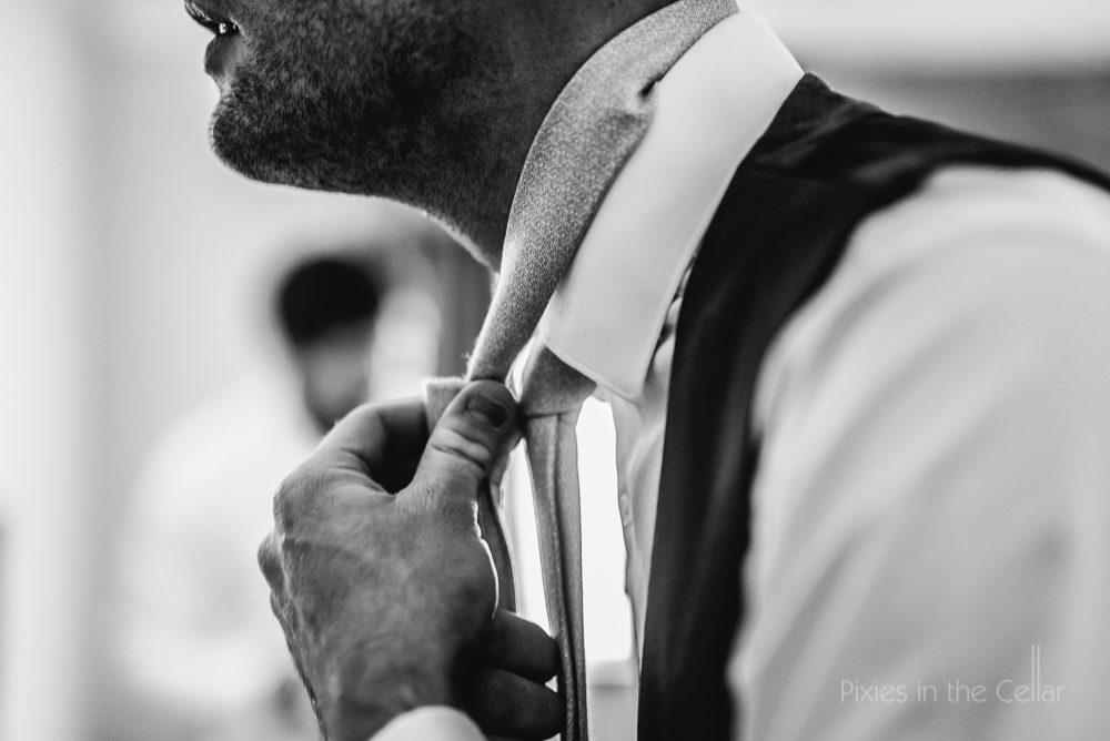groom with tie