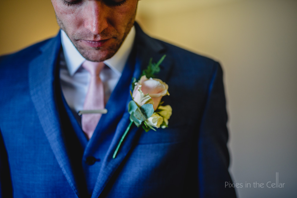 thinking groom blue suit