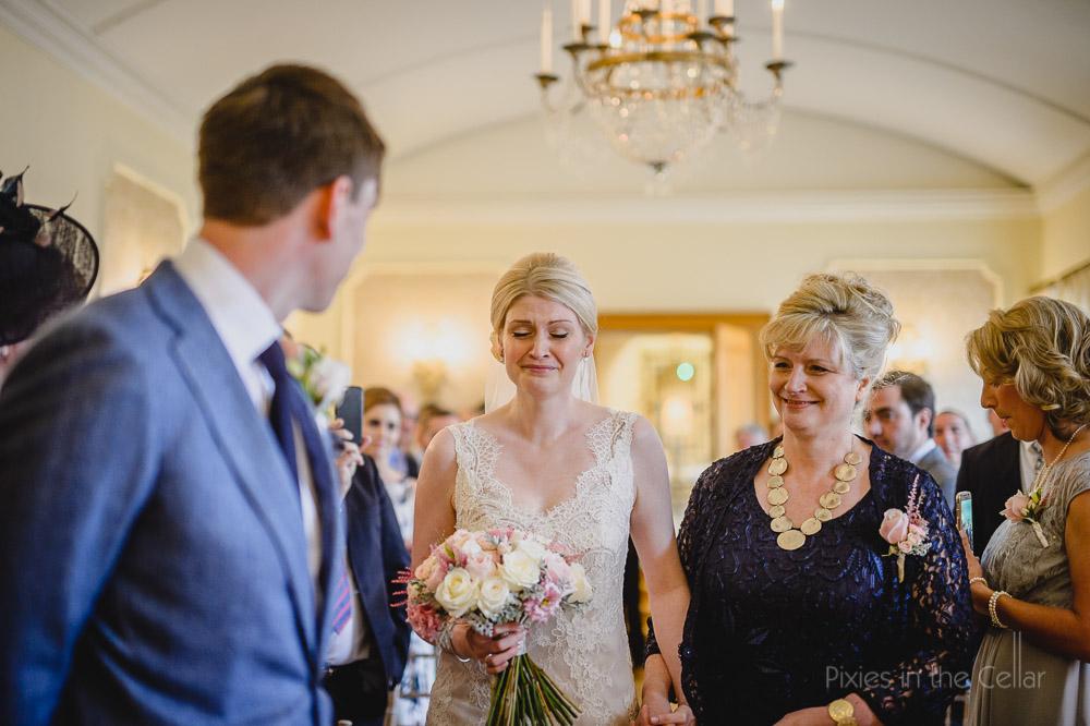 bride mum walking down aisle