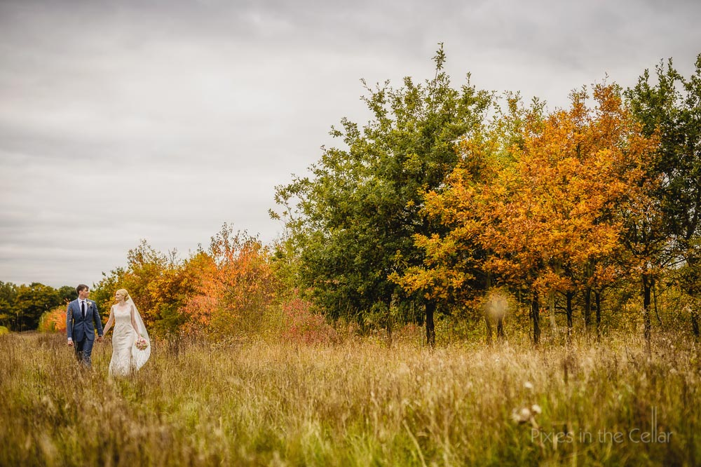 Autumn wedding bride groom walking