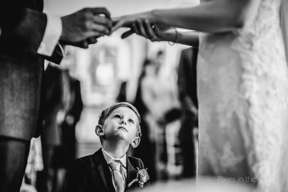 cute page boy exchanging wedding rings