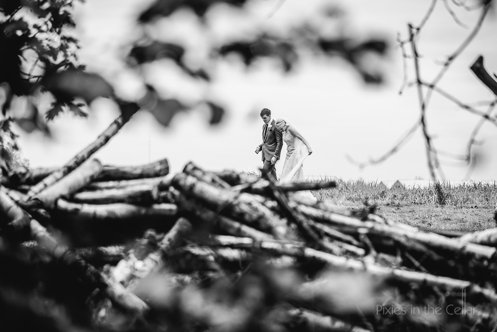 bride groom walking wood pile