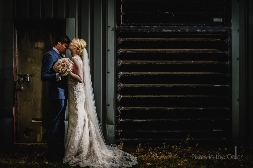 bride groom kissing grungy