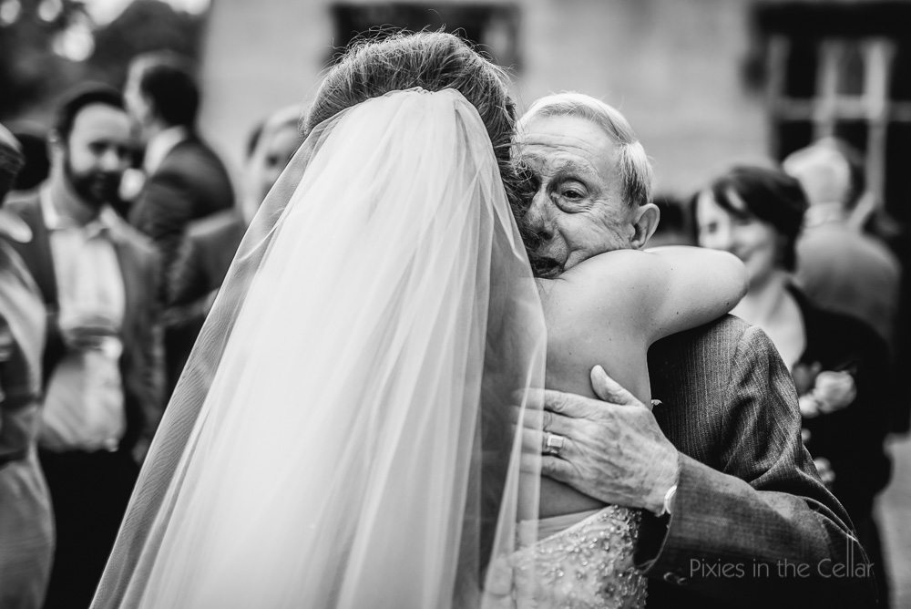 bride hugs grandad