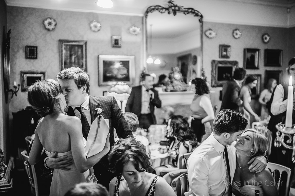wedding guests kissing