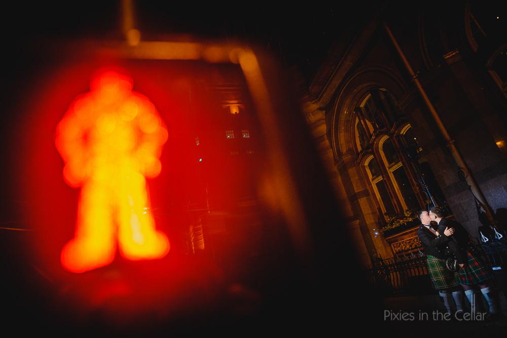 Gay wedding photography night time lit man Midland Hotel Manchester