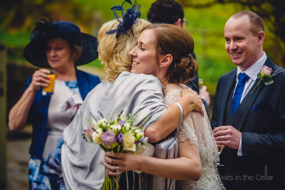 bride mum hug
