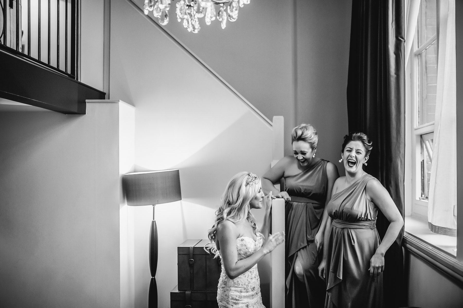 three bridesmaid friends laughing