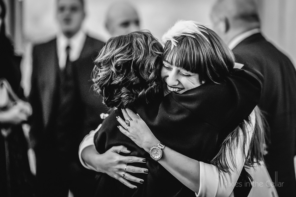 wedding guest hugs