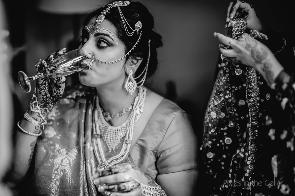 Hindu bride and champagne
