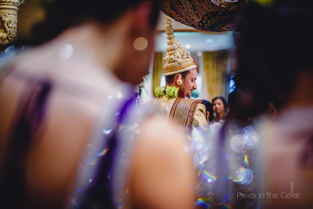 english groom bengali hat