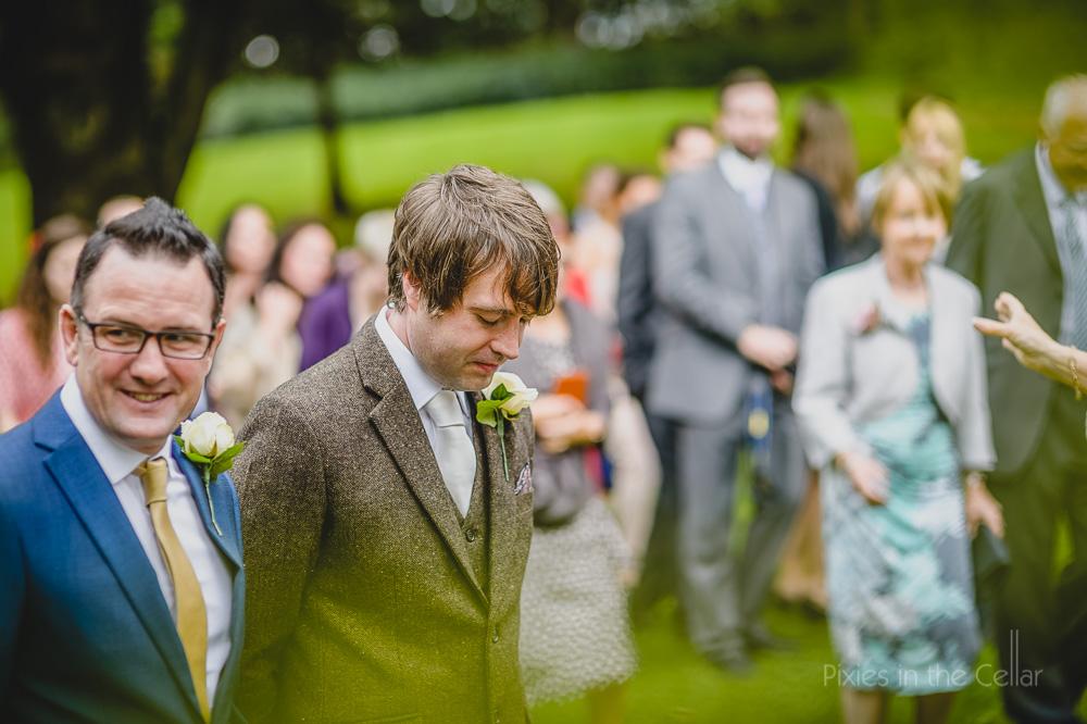 groom waiting in tweed