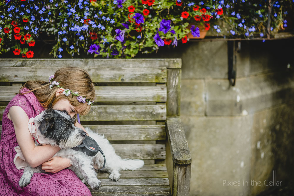 girl and dog hug