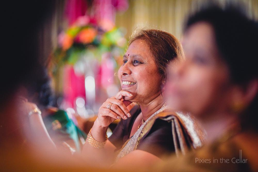 smiley wedding guest hindu wedding