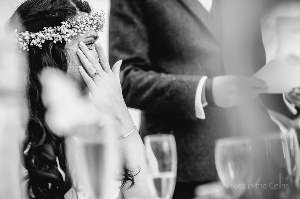 bride wiping tears away