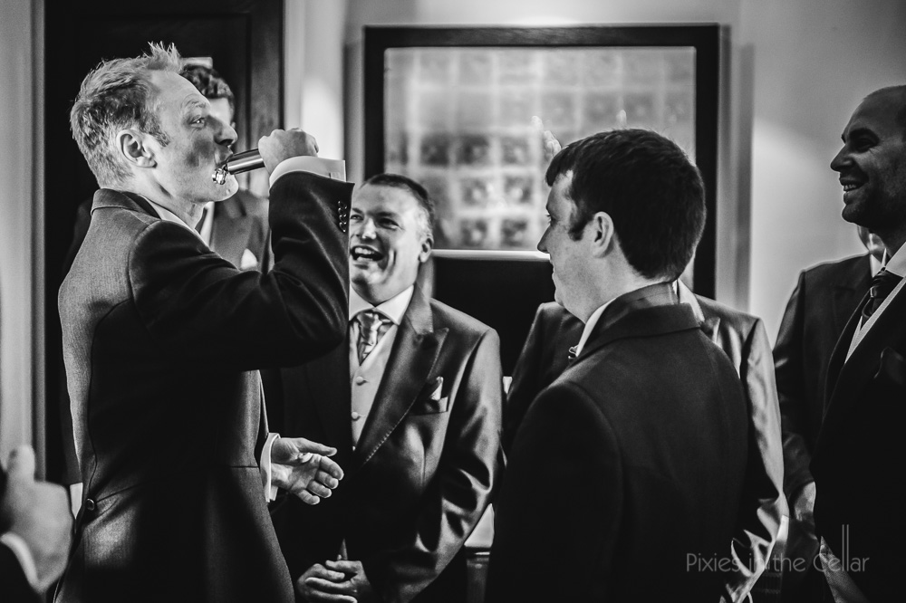 groom drinking from hipflask