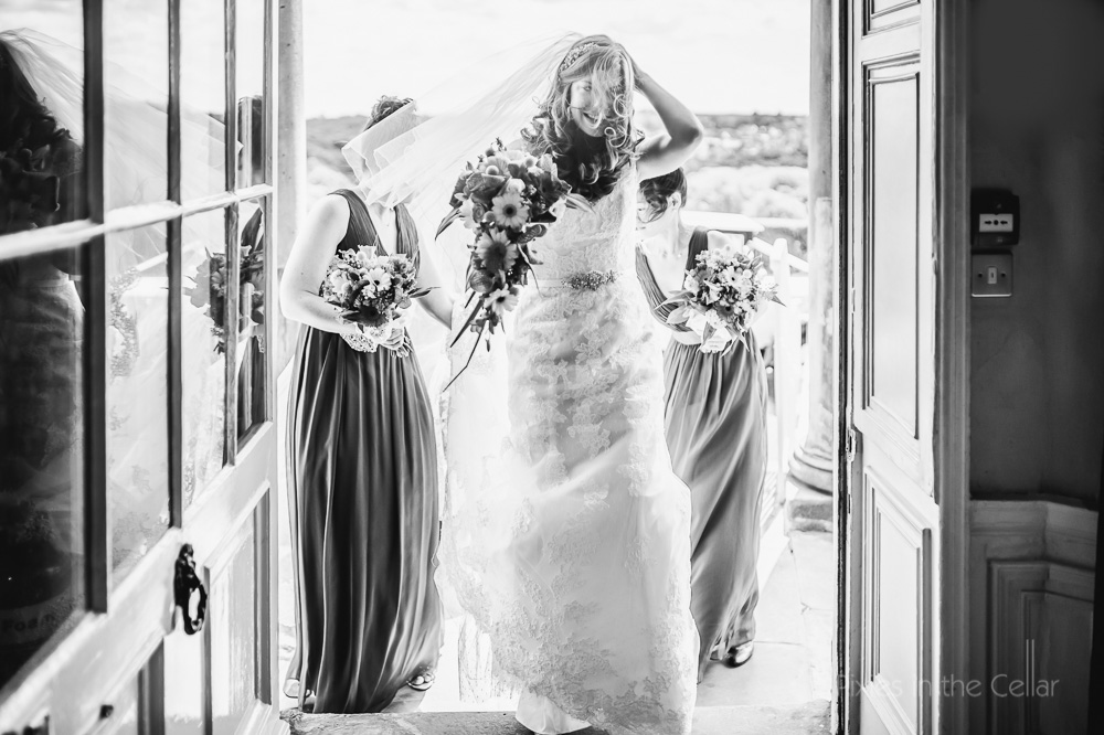 arrival of bride on windy day