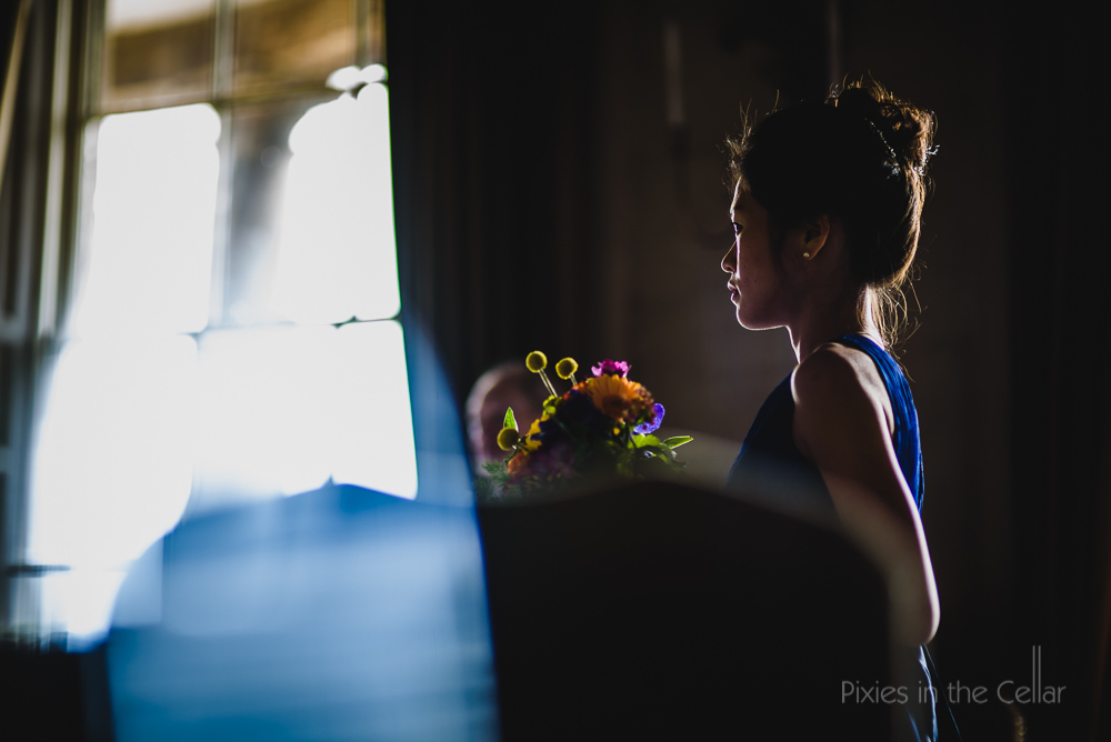 royal blue bridesmaid and colourful flowers