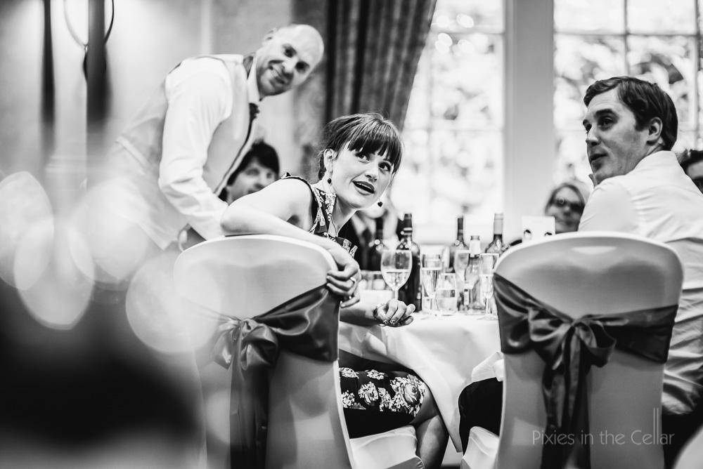 wedding guests sat at table
