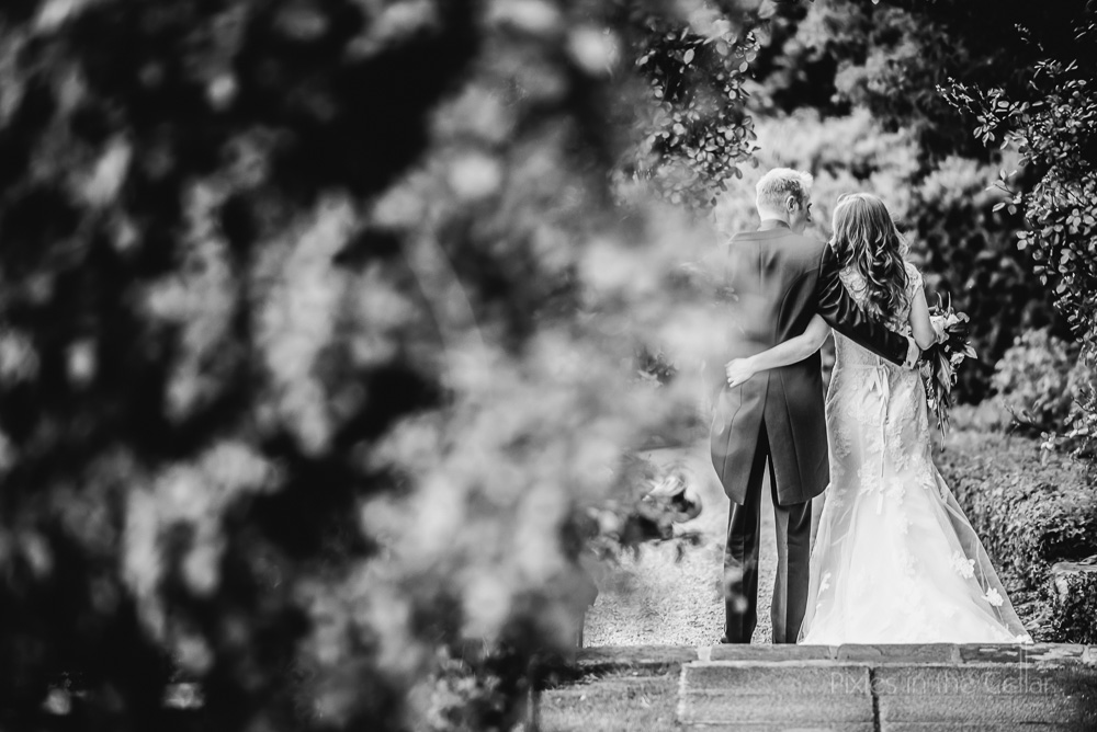 back of bride and groom walking away