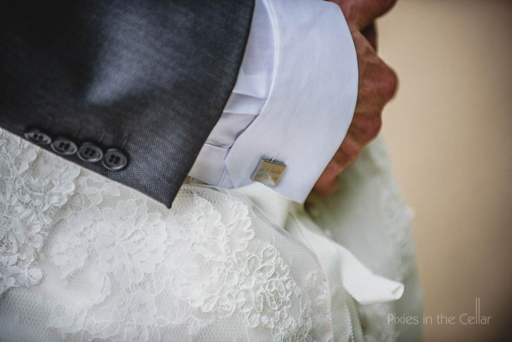cufflink and bride dress detail