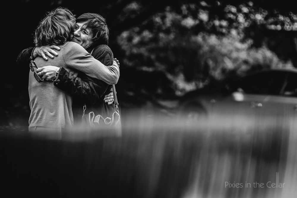 friends hug black and white image