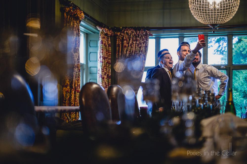 groomsmen selfie mitton hall winter wedding