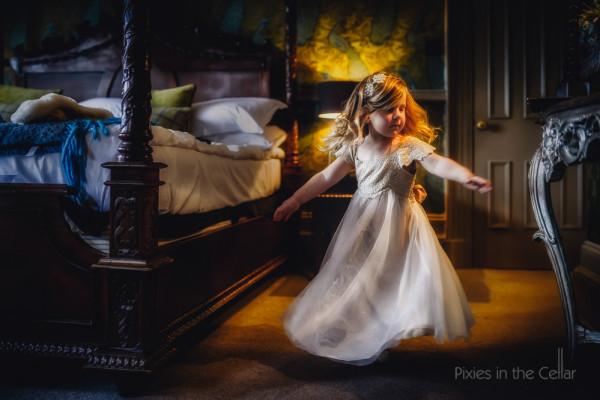 Mitton Hall winter wedding photography flowergirl twirling