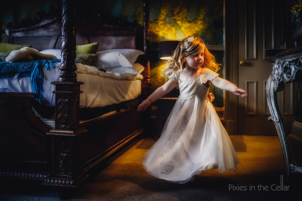 Mitton Hall winter wedding photography flowergirl twirling